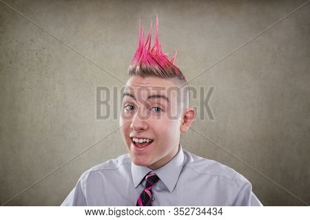Smiling teen with a pink mohawk haircut