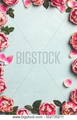 Border of beautiful pink tulips on blue shabby chic background