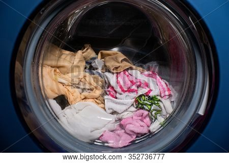 Washing Machine In Bathroom Clothes In The Washing Machine. Cleaning Washing