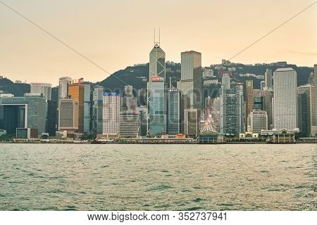 HONG KONG, CHINA - CIRCA JANUARY, 2019: Central District as seen from Victoria Harbour at twilight.