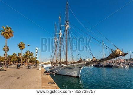 BARCELONA, SPAIN - JANUARY 13, 2015: Promenade and Santa Eulalia - three-masted schooner built in 1918 under the name Carmen Flores. It was bought and renamed by Maritime Museum of Barcelona in 1997.