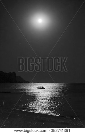 Moonlit Night At Sea. Moonlight Track On The Surface Of The Water. Sudak, Crimea.(black And White Ve
