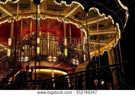 Carousel Merry-go-round With Light At Night, Christmas City In The Dark, Amusement Park, Partial Vie