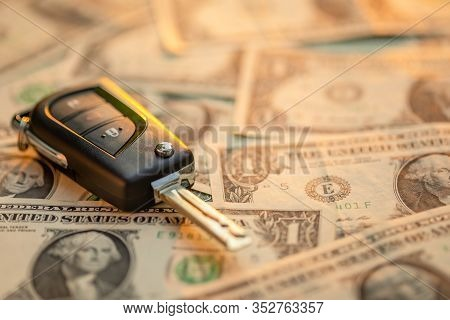 New Car Keys With Us Dollar Banknote On Wooden Table. Car Purchase Or Car Rental Concept