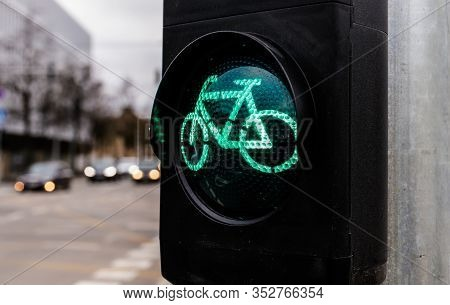 Traffic Light For Cyclists. Green Light For Bycicle Lane On A Traffic Light. Traffic Light In Green