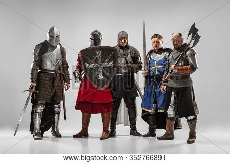 Brave Armored Knights With Professional Weapon Fighting Isolated On White Studio Background. Histori