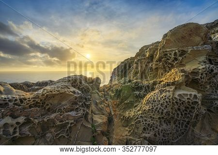 Rocks Eroded By The Wind And Sea In Populonia Cliff Buca Delle Fate At Sunset. Piombino, Maremma Tus