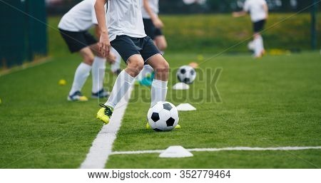 Sports Soccer Players On Training. Boys Kicking Soccer Ball On Practice Session. Kids Playing Soccer