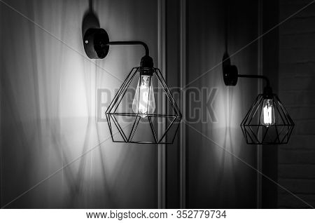 Black And White Stock Photo Of Modern Pendant Light In Diamond Shape Wire Lampshade With Light Bulb