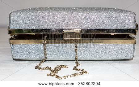 Glittery Silver Clutch Bag Isolated On White Background With Copy Space.