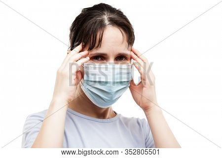 Human population virus, infection, flu disease prevention and industrial exhaust emissions protection concept - beauty woman wearing respiratory protective medical mask suffers headache white isolated