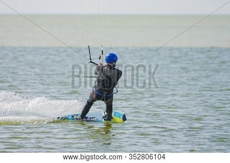 Russia, Stanitsa Dolzhanskaya - September 22, 2014; An Athlete Is Engaged In Kiting On A Windy Day I