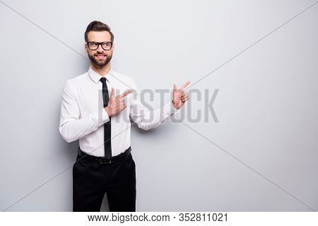 Photo Of Attractive Business Man Professional Indicate Fingers Look Interested Empty Space Advising