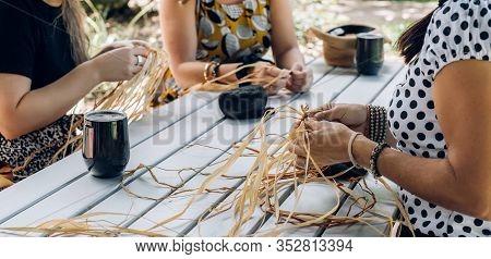 Females Weaving Baskets On The Craft Workshop. Hands Holding The Craftwork, Close Up Shot.
