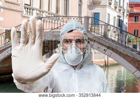 Doctor In Coveralls Warns Of Coronavirus Infection In Venice In Italy.