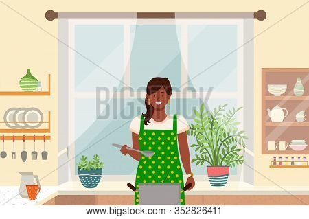 Woman Stand By Surface In Kitchen At Home. Lady Boil Soup In Pan. Cozy Room Interior With Big Window