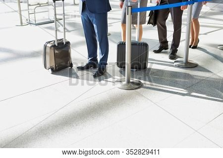 Business people queueing for check in airport