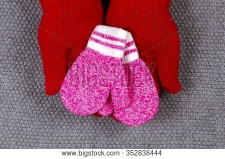 Baby Pink Mittens. The Concept Of Family Care And Joy