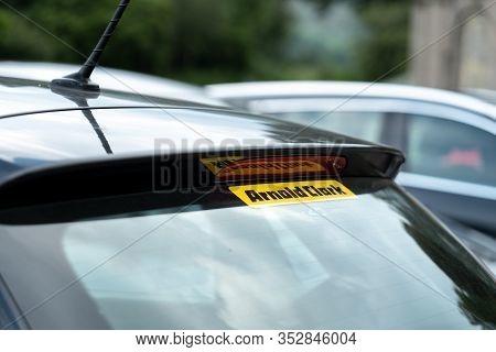 Glasgow, Scotland - August 1, 2019: The Rear Spolier Of A Dark Blue Car With A Arnold Clark Company