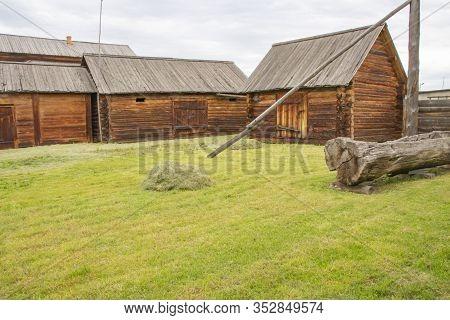 Farmyard Of An Old Manor, Vintage Log Buildings.