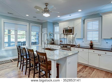 Beautiful luxury kitchen with quarz countertops and view windows.