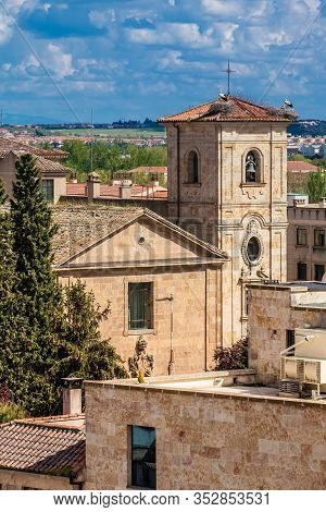 Storks Nesting On Top Of The Bell Tower Of Church Of Carmen De Abajo Built On The 15Th Century In Th