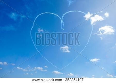 Plane Doing Acrobatic Formation And Creating A Heart Shape In The Blue Sky. . Airplanes On Airshow