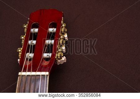 Head And Nut Of A Guitar Close Up. Strings And Frets On The Neck Of The Guitar. Musical Instrument O