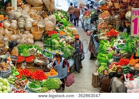 SUCRE / BOLIVIA - APRIL 10, 2018: Local market in the city of Sucre in Bolivia full of hand made products and fresh vegetables