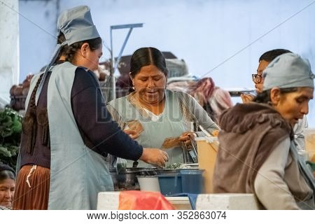 SUCRE / BOLIVIA - APRIL 10, 2018: People on the local market in the city of Sucre in Bolivia