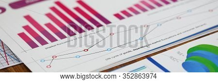 Close-up Of Biz Documents With Statistics Data In Charts, Graphs And Diagrams. Financial Forecast Of