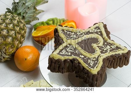 Dessert For A Loved One Vegan For The Holiday. Angle View. Star-shaped Chocolate Cake With A Heart I