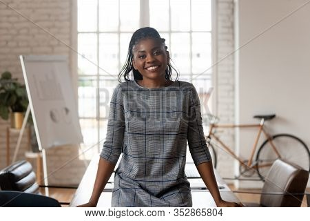 Successful Confident African Businesswoman Looking At Camera Posing In Boardroom