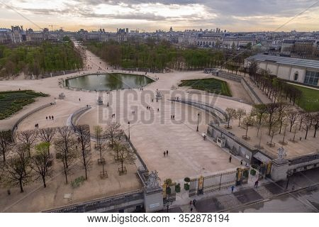 Paris, France - March 28, 2017: Local and Tourist enjoy sunny days in famous Tuileries garden (Jardin des Tuileries). Public Tuileries Garden created by Catherine de Medici in 1564 in Paris