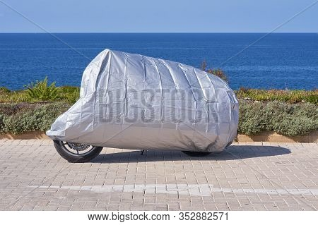 Waterproof Cover For Motorcycle With Silver Reflective Protective Surface. Motorbike Covered With Fa
