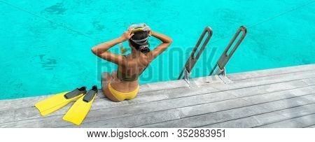 Beach Caribbean watersport active girl going snorkeling in crystalline blue ocean waters summer vacation sport. Snorkel lesson panoramic banner.