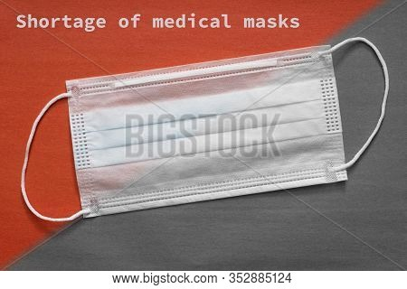 Shortage Of Medical Masks Concept. An Outbreak Of Coronavirus Has Led To A Shortage Of Surgical Face