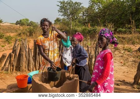 Bissau, Republic of Guinea-Bissau - February 6, 2018: women and children at the well for water, in the city of Bissau, Guinea Bissau