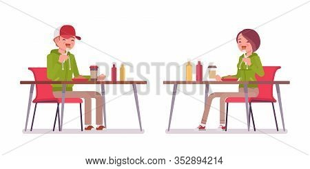 Young Man, Woman Eating Lunch At Table In Cafe Or Canteen, Wearing Hoodie Jacket. Cute Smart People
