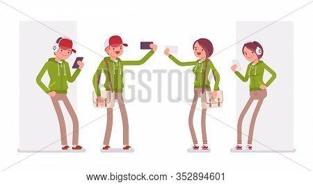 Young Man, Woman Taking Self Portraits, Listening In Headphones, Wearing Hoodie Jacket. Cute Smart P