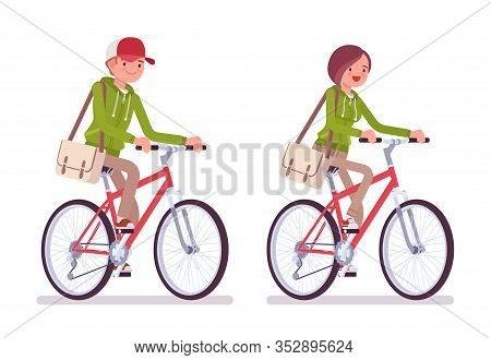 Young Man And Woman Wearing A Hoodie Jacket Riding Bike. Cute Smart People In Casual Green Hoody Enj