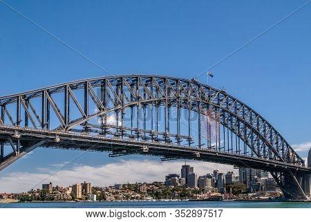 Sydney, Australia - December 11, 2009: Harbour Bridge, Full Metal Span, Bow Against Blue Sky And Abo