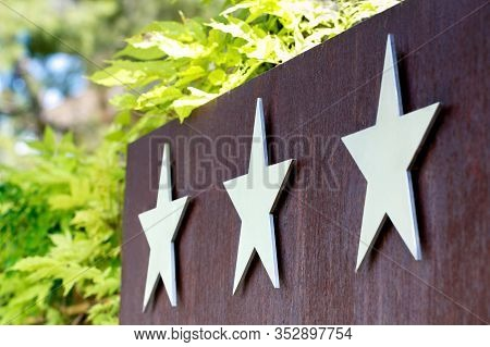 Metallic Hotel Sign Board With Three Star. Quality Service, Buyer Choice.