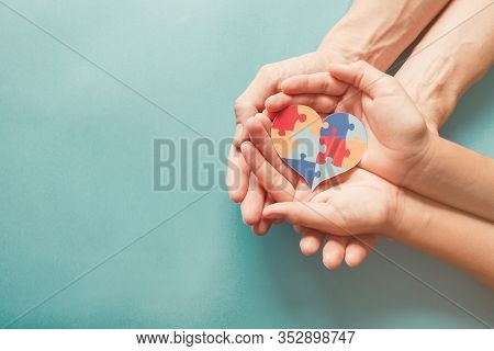 Adult And Chiild Hands Holding Jigsaw Puzzle Heart Shape, Autism Awareness, Autism Spectrum Family S
