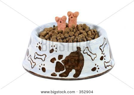 poster of dish of dog food with two dog treats sticking out