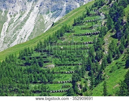 Protection Against Avalanches In The Liechtenstein Alps Mountain Range Or Wooden Fences As Protectio