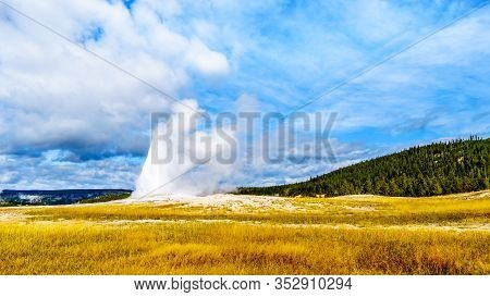 The Start Of An Eruption Of The Famous Old Faithful Geyser A Cone Geyser In The Upper Geyser Basin A