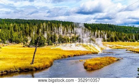 Steam Coming From The Riverside Geyser On The Firehole River In The Upper Geyser Basin Along The Con