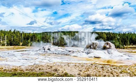 Steam Coming Out Of The Grand Geyser In The Upper Geyser Basin Along The Continental Divide Trail In