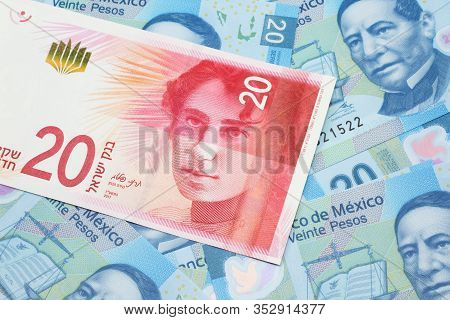 A Close Up Image Of A Twenty Israeli Shekel Bank Note From Israel On A Background Of Mexican Twenty